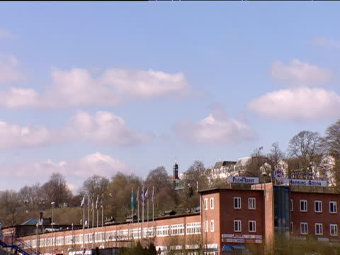 track left from boat along river elbe past huge chimney stack high rise flats and other buildings hamburg - other stock videos & royalty-free footage