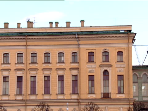 track left from boat along tall buildings st petersburg - fensterfront stock-videos und b-roll-filmmaterial