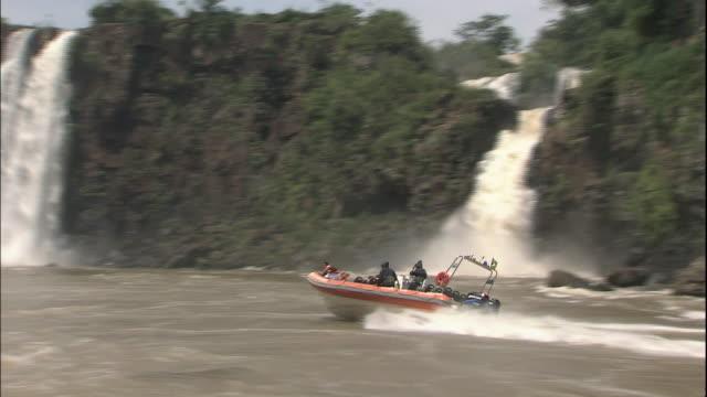 Track left from boat towards Iguazu Falls, border of Brazil and Argentina