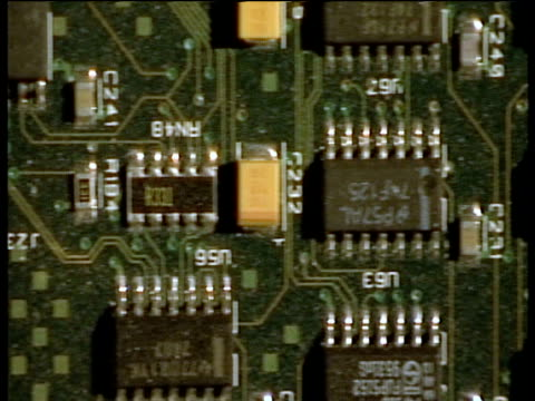 track left over computer chipboard showing intricate electronic and cyber systems - computer chip stock videos & royalty-free footage