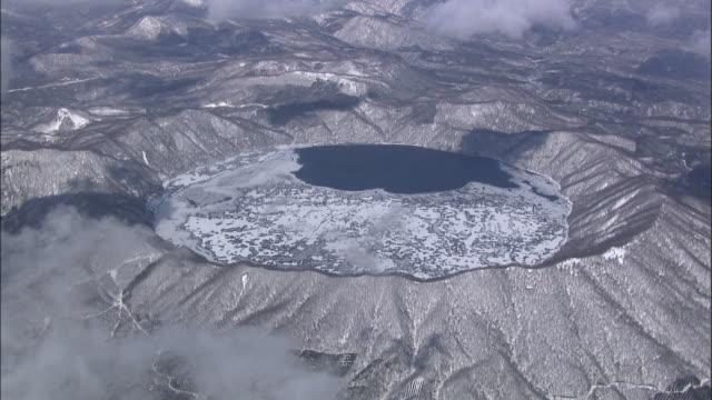 Track left over frozen Lake Kuttara, Japan