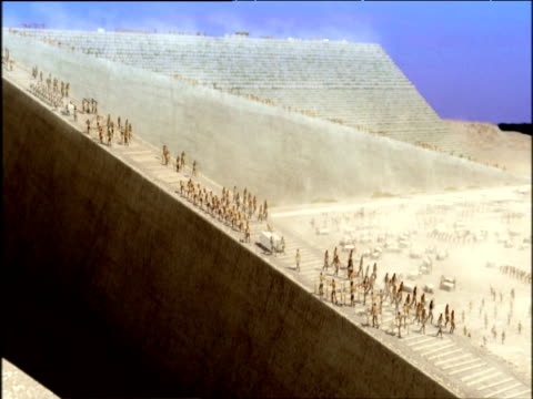 track left over reconstruction of ancient egyptians building pyramids giza - pyramid stock videos and b-roll footage