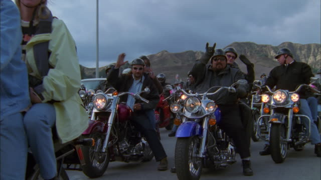 track left past convoy of bikers on freeway, california available in hd. - biker gang stock videos & royalty-free footage
