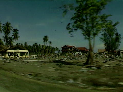 Track left past devastation to Banda Aceh caused by tsunami Indonesia 12 Jan 05