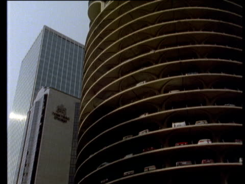 track left past marina city complex buildings also known as corn cob buildings cars parked on upper levels of building carpark are visible - stationary stock videos & royalty-free footage