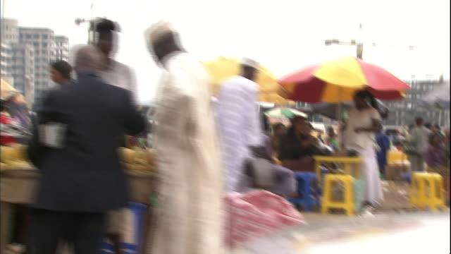 track left past roadside market, abuja, nigeria - retail occupation stock videos & royalty-free footage