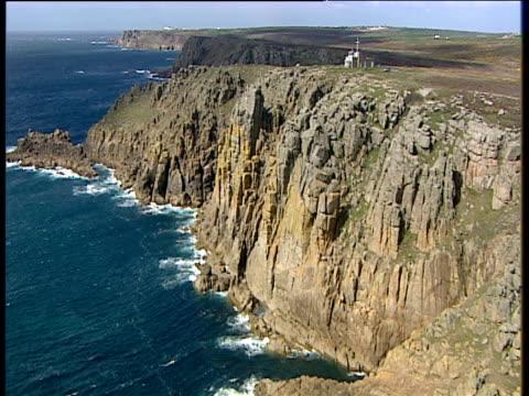 track left past rugged cliffs around gwennap head coastwatch station on clifftop cornwall - ムラがある点の映像素材/bロール