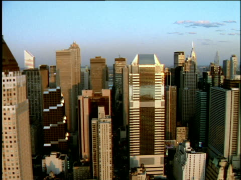 track left past skyscrapers of manhattan skyline - citigroup center manhattan stock videos & royalty-free footage