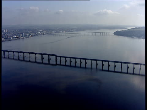 track left past tay rail bridge with tay road bridge in background firth of tay dundee - dundee scotland stock videos and b-roll footage