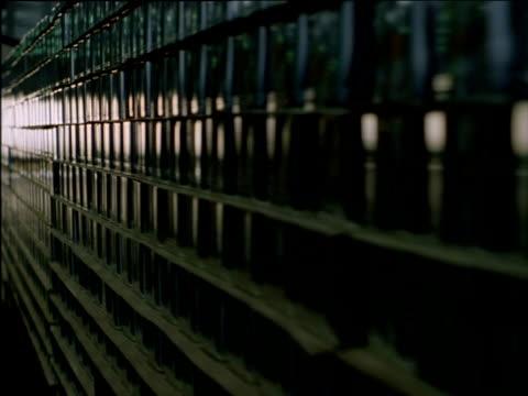 track left stacks of square steel cans - sn�� bildbanksvideor och videomaterial från bakom kulisserna