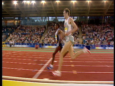 track left to follow haile gebrselassie beating craig mottram and winning men's 5000m 2004 crystal palace grand prix london - men's track stock videos and b-roll footage