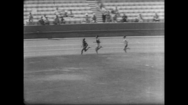 track meet at the los angeles coliseum / athletes parade around the track / 1500 meters race begins / kipchoge keino of kenya and jim ryan of the... - world record stock videos & royalty-free footage