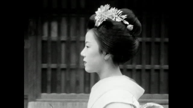 ms track of geisha walking along street in profile; 1966 - femininity stock videos & royalty-free footage