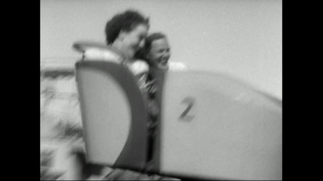 track of two girls riding the fast octopus ride;1951 - only teenage girls stock videos & royalty-free footage
