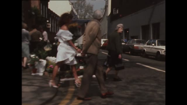 track of woman in white dress walking along street - 1982 stock videos & royalty-free footage