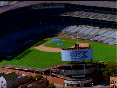 track over and zoom out and in to wrigley fields baseball stadium, home to the chicago cubs - baseball diamond stock videos and b-roll footage