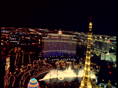 track over bellagio fountains and casino at night, las vegas - casino stock videos & royalty-free footage