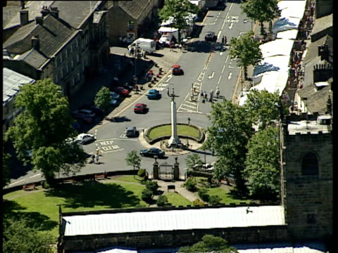 track over centre of skipton with market stalls on high street yorkshire - スキップトン点の映像素材/bロール