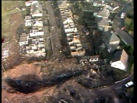 track over damaged houses and large crater at the scene of major crash impact lockerbie air disaster 22 dec 88 - lockerbie stock videos & royalty-free footage