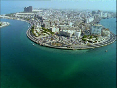 track over downtown city buildings with traffic on city roads next to dubai creek dubai - bbc archive stock-videos und b-roll-filmmaterial