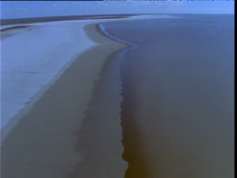 track over edge of massive salt lake, lake eyre, south australia - at the edge of stock videos and b-roll footage