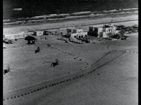 track over el gamil raf base with helicopters and lorries parked on sand suez crisis egypt 22 nov 56 - politik und regierung stock-videos und b-roll-filmmaterial
