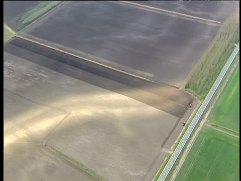 track over farmland on fen - fen stock videos and b-roll footage