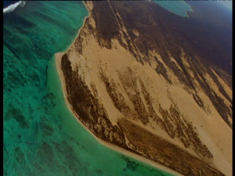 track over fringing green ningaloo reef and coast, western australia - ningaloo reef stock videos & royalty-free footage