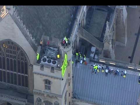track over greenpeace protestors on roof of houses of parliament london 12 october 2009 - 2000s style stock videos & royalty-free footage