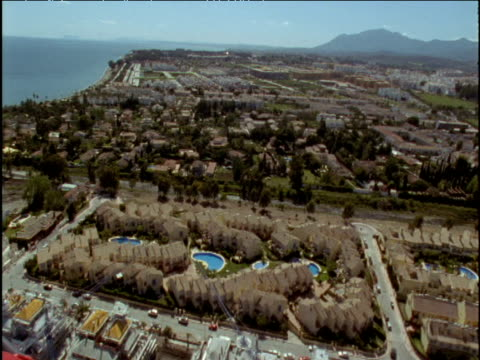 stockvideo's en b-roll-footage met track over holiday properties marbella spain - buitenbad