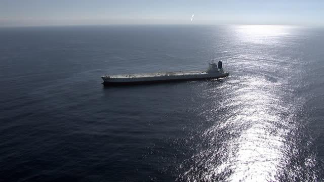 Track over huge oil supertanker, Pacific Ocean
