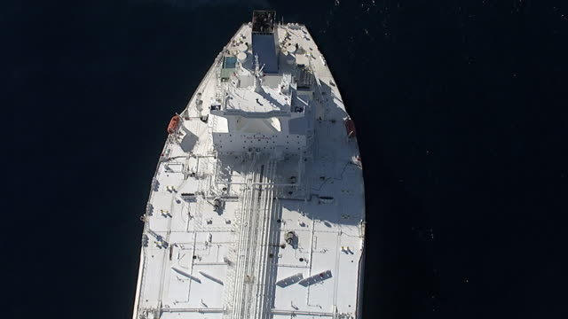 Track over huge oil supertanker, Pacific Ocean