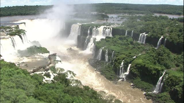 Track over Iguazu Falls, border of Brazil and Argentina, Aerial Shot