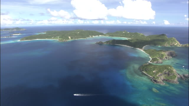 Track over Kerama Islands surrounded by coral reef in blue sea, Okinawa, Japan, Diving Shot