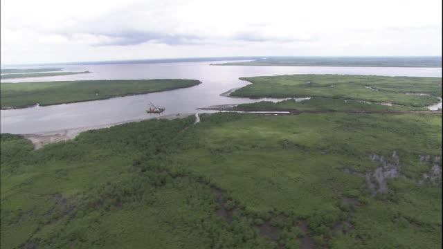 Track over Niger Delta at Port Harcourt, Nigeria, Aerial Shot