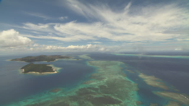 track over ocean and islands. - pacific islands stock videos & royalty-free footage