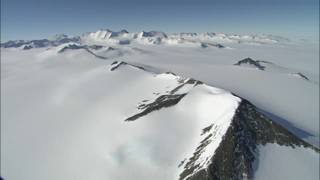 Track over peaks of mountain range buried under ice sheet