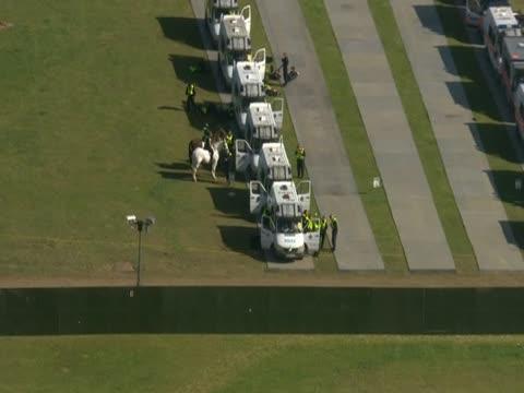 track over police cars parked in a field near dale farm essex - デールファーム点の映像素材/bロール