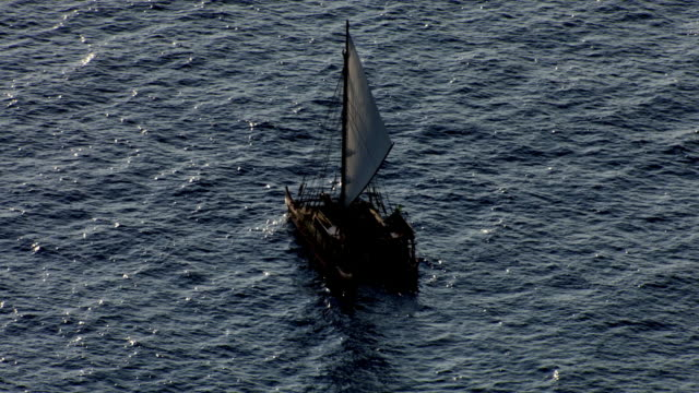 track over polynesian canoe sailing on pacific ocean, hawaii - polynesian culture stock videos & royalty-free footage
