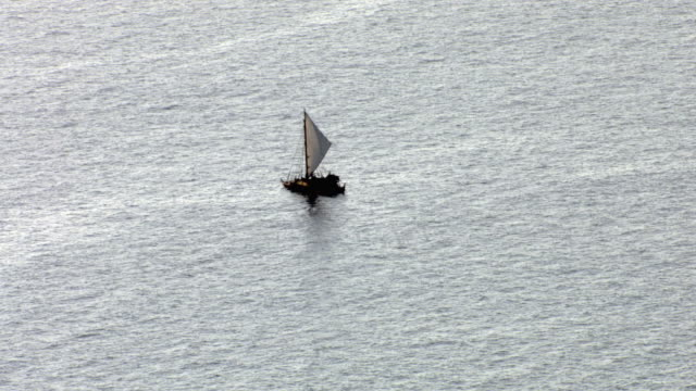 track over polynesian canoe sailing on pacific ocean, hawaii - polynesian ethnicity stock videos and b-roll footage