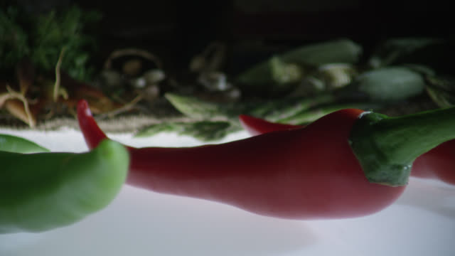 track over red and green chillies, uk - medium group of objects stock videos & royalty-free footage