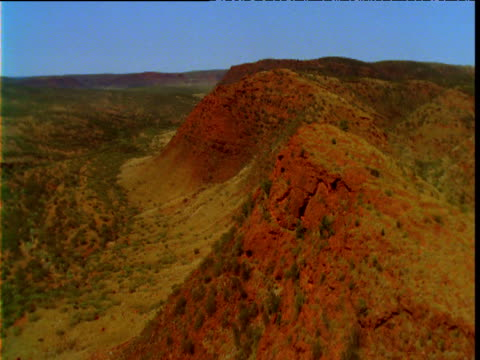 track over red sandstone ridge in outback, northern territory, australia - sandstone stock videos & royalty-free footage