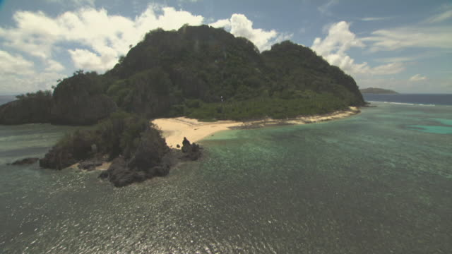 track over rocky island. - south pacific ocean stock videos & royalty-free footage
