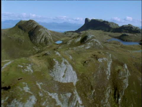 track over rugged hills and lake scottish highlands - ムラがある点の映像素材/bロール