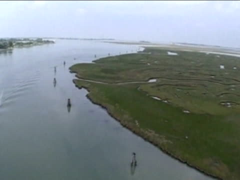 Track over salt marshes that provide natural defence to high tide during floods Venice 17 Jul 02