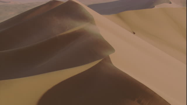 Track over sand blown crest of desert dune, Sossusvlei, Namibia