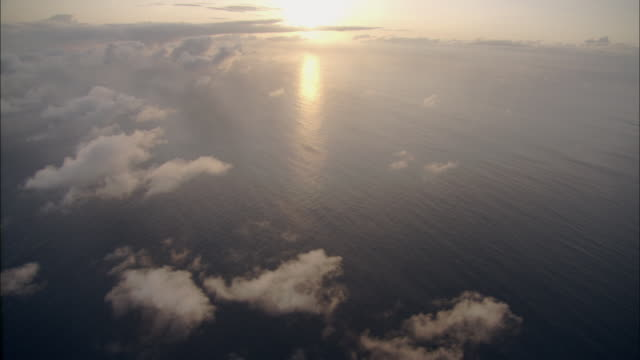 track over sea and clouds towards sunset available in hd. - blank stock videos and b-roll footage
