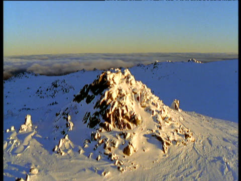 track over small snowy peak in australian alps, victoria, australia - australian alps stock videos & royalty-free footage