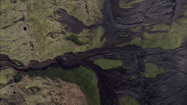 track over solidified lava flows between green hills, fernandina, galapagos islands available in hd. - なだらかな起伏のある地形点の映像素材/bロール
