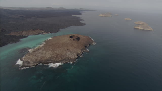 track over sombrero chino island available in hd. - galapagos islands stock videos & royalty-free footage